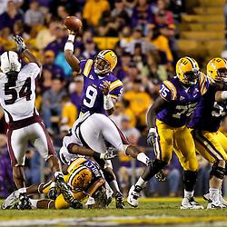 November 13, 2010; Baton Rouge, LA, USA; LSU Tigers quarterback Jordan Jefferson (9) throws a pass as Louisiana Monroe Warhawks linebacker Jason Edwards (54) pressures during the first half at Tiger Stadium. LSU defeated Louisiana-Monroe 51-0.  Mandatory Credit: Derick E. Hingle