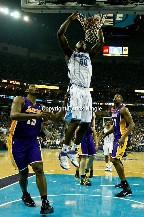 April 24, 2011; New Orleans, LA, USA; New Orleans Hornets center Emeka Okafor (50) dunks over Los Angeles Lakers small forward Ron Artest (15) during the first half in game four of the first round of the 2011 NBA playoffs at the New Orleans Arena. The Hornets defeated the Lakers 93-88.   Mandatory Credit: Derick E. Hingle