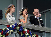 © Licensed to London News Pictures. 02/06/2012. London, UK. HRH Prine Phillip points with Sisters Princess Eugenie (L) Princess Beatrice HRH Queen Elizabeth at The Investic Derby Festival today 2nd June 2012. The Royal Jubilee celebrations. Great Britain is celebrating the 60th  anniversary of the countries Monarch HRH Queen Elizabeth II accession to the throne this weekend Photo credit : Stephen Simpson/LNP