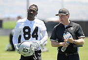 May 28, 2019; Alameda, CA,  USA; Oakland Raiders receiver Antonio Brown (84) is escorted by media relations director Will Kiss during organized team activities at the Raiders practice facility.