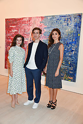 Left to right, Maria Behnam-Bakhtiar, artist Sassan Behnam-Bakhtiar and Nina Moaddel at a preview of an exhibition of art by Sassan Behnam-Bakhtiar entitled 'Oneness Wholeness' held at the Saatchi Gallery, Duke of York's HQ, King's Rd, London, England. 14 May 2018.