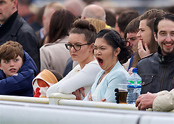 LIVERPOOL, ENGLAND - Thursday, April 6, 2017: A racegoer yawns, during The Opening Day on Day One of the Aintree Grand National Festival 2017 at Aintree Racecourse. (Pic by David Rawcliffe/Propaganda)