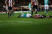 Rudy GESTEDE head injury during the Sky Bet Championship match between Brentford and Blackburn Rovers at Griffin Park, London, England on 13 December 2014.