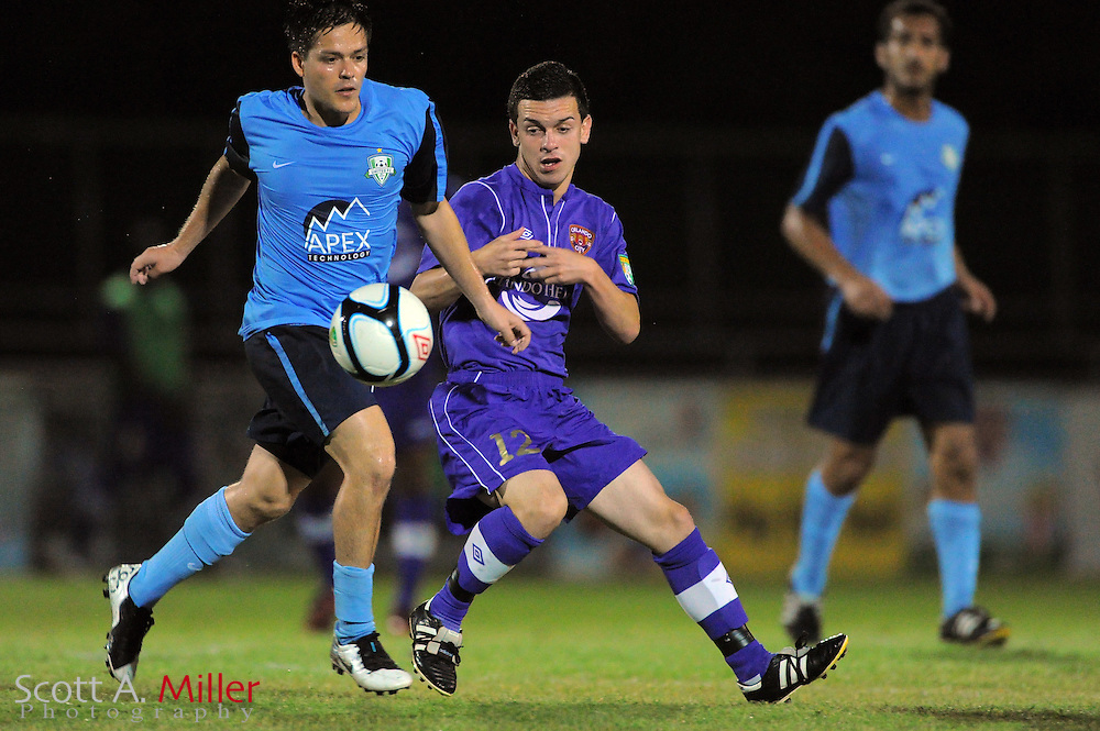Orlando City U23 player David Graydon (12) and Jacksonville United's Enrique Haussler (5) fight for the ball during their US Open Cup game against on May 15, 2012 in Sanford, Fla. ..©2012 Scott A. Miller..