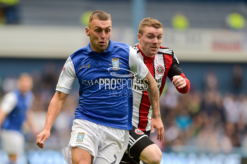 Sheffield Wednesday defender Jack Hunt (2)   and Sheffield United midfielder John Fleck (4) during the EFL Sky Bet Championship match between Sheffield Wednesday and Sheffield Utd at Hillsborough, Sheffield, England on 24 September 2017. Photo by Adam Rivers.