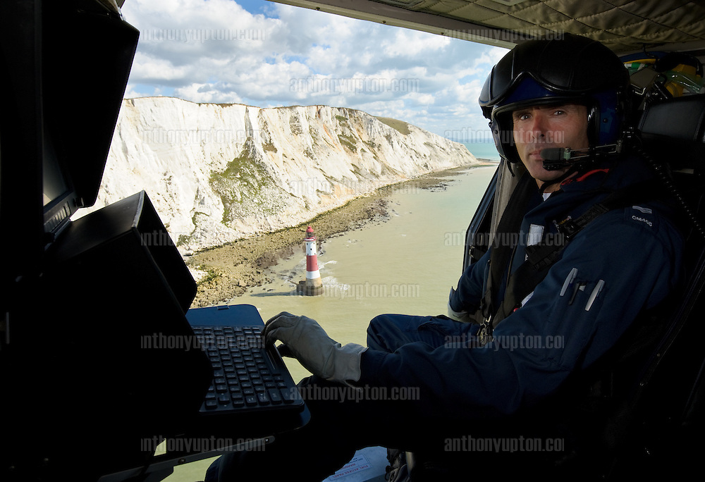 20100818                 Copyright image 2010©..Sargent Andy McMahon, Air Observer with Sussex Police Air Operations Unit flying over Beachy Head and Brighton Marina . .For the Commando 999 Calendar. .Mandatory Credit Ant Upton otherwise additional charges will apply..For photographic enquiries please call Anthony Upton 07973 830 517 or email info@anthonyupton.com .This image is copyright Anthony Upton 2010©..This image has been supplied by Anthony Upton and must be credited Anthony Upton. The author is asserting his full Moral rights in relation to the publication of this image. All rights reserved. Rights for onward transmission of any image or file is not granted or implied. Changing or deleting Copyright information is illegal as specified in the Copyright, Design and Patents Act 1988. If you are in any way unsure of your right to publish this image please contact Anthony Upton on +44(0)7973 830 517 or email: