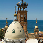 Exterior dome and bell tower of church from behind. Puerto Vallarta, Jalisco. Mexico.