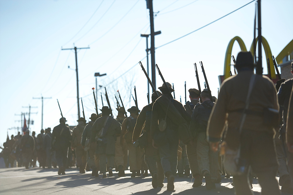 Troops march past a McDonald's at the conclusion of the Remembrance Day Parade in Gettysburg, PA ,celebrating the 149th anniversary of the Gettysburg Address, on November 17, 2012.
