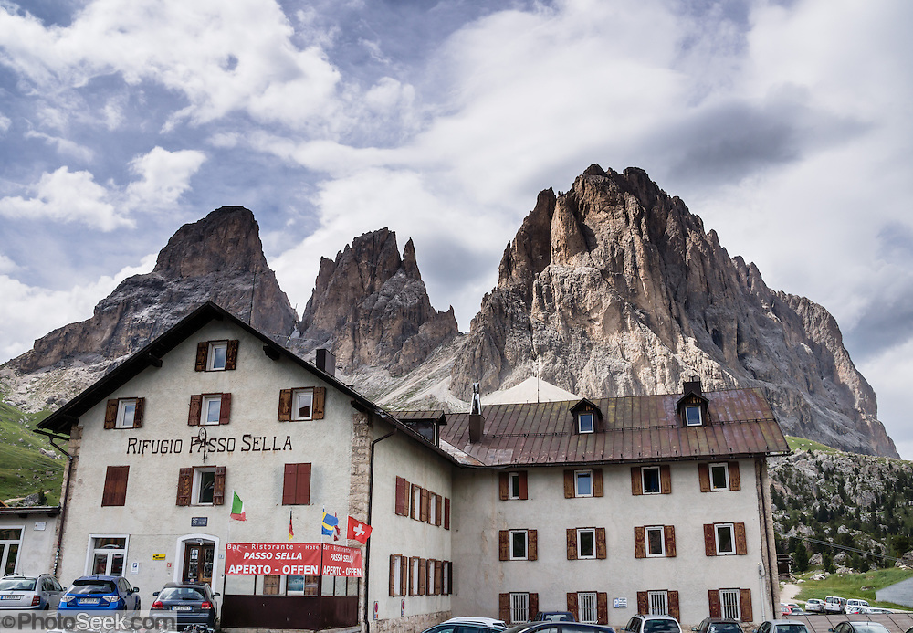 Rifugio Passo Sella provides scenic roadside lodging beneath the Langkofel/Sassolungo Group at Passo Sella, above Val Gardena/Gröden in the Dolomites, South Tyrol, Italy, Europe. For a scenic walk from Selva di Val Gardena, take the Ciampinoi lift for views of Alpe di Siusi then hike to Passo Sella and return by bus. The beautiful ski resort of Selva di Val Gardena (German: Wolkenstein in Gröden; Ladin: Sëlva Gherdëine) makes a great hiking base in the Dolomites, in the South Tyrol region (Trentino-Alto Adige/Südtirol) of Italy, Europe. UNESCO honored the Dolomites as a natural World Heritage Site in 2009.
