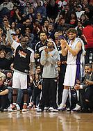 Feb. 4, 2011; Phoenix, AZ, USA; Phoenix Suns bench Mickael Pietrus (left) Garret Siler , Zabian Dowdell , and Robin Lopez react while playing against the Oklahoma City Thunder at the US Airways Center. The Thunder defeated the Suns 111-107. Mandatory Credit: Jennifer Stewart-US PRESSWIRE.