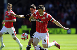 Bristol City's Sam Baldock battles for the ball with Walsall's Andrew Butler  - Photo mandatory by-line: Joe Meredith/JMP - Mobile: 07966 386802 12/04/2014 - SPORT - FOOTBALL - Walsall - Banks' Stadium - Walsall v Bristol City - Sky Bet League One