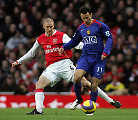 Photo: Paul Thomas.<br /> Arsenal v Manchester United. The Barclays Premiership. 21/01/2007.<br /> <br /> Ryan Giggs (R) of Man Utd is shadowed by Philippe Senderos.