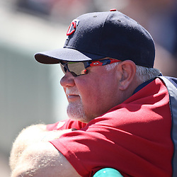 March 13, 2011; Fort Myers, FL, USA; Minnesota Twins manager Ron Gardenhire (35) watches infield practice before a spring training exhibition game against the Philadelphia Phillies at Hammond Stadium.   Mandatory Credit: Derick E. Hingle
