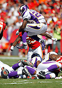 Minnesota Vikings running back Adrian Peterson (28) jumps in the air on a second quarter run during the NFL week 4 football game against the Kansas City Chiefs on Sunday, October 2, 2011 in Kansas City, Missouri. The Chiefs won the game 22-17. ©Paul Anthony Spinelli