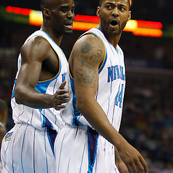 Mar 08, 2010; New Orleans, LA, USA; New Orleans Hornets center Emeka Okafor (50) holds back guard Morris Peterson (24) as he argues with an official during the first half against the Golden State Warriors at the New Orleans Arena. Mandatory Credit: Derick E. Hingle-US PRESSWIRE