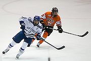 Air Force forward Max Hartner and RIT forward Garrett McMullen skate during the Atlantic Hockey semifinal at the Blue Cross Arena at the War Memorial in Rochester on Friday, March 18, 2016.