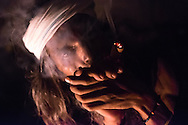 A Holy man smokes marijuana in Varanasi india