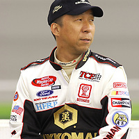 Hideo Fukuyama waits for his turn to qualify for the running of the Auto Clulb 500 NASCAR Winston Cup race at the California Speedway in Fontana, California.