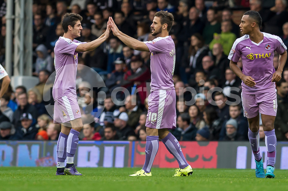 Orlando Sá of Reading celebrates with Lucas Piazón of Reading the second goal of his team during the Sky Bet Championship match between Fulham and Reading at Craven Cottage, London, England on 24 October 2015. Photo by Salvio Calabrese.