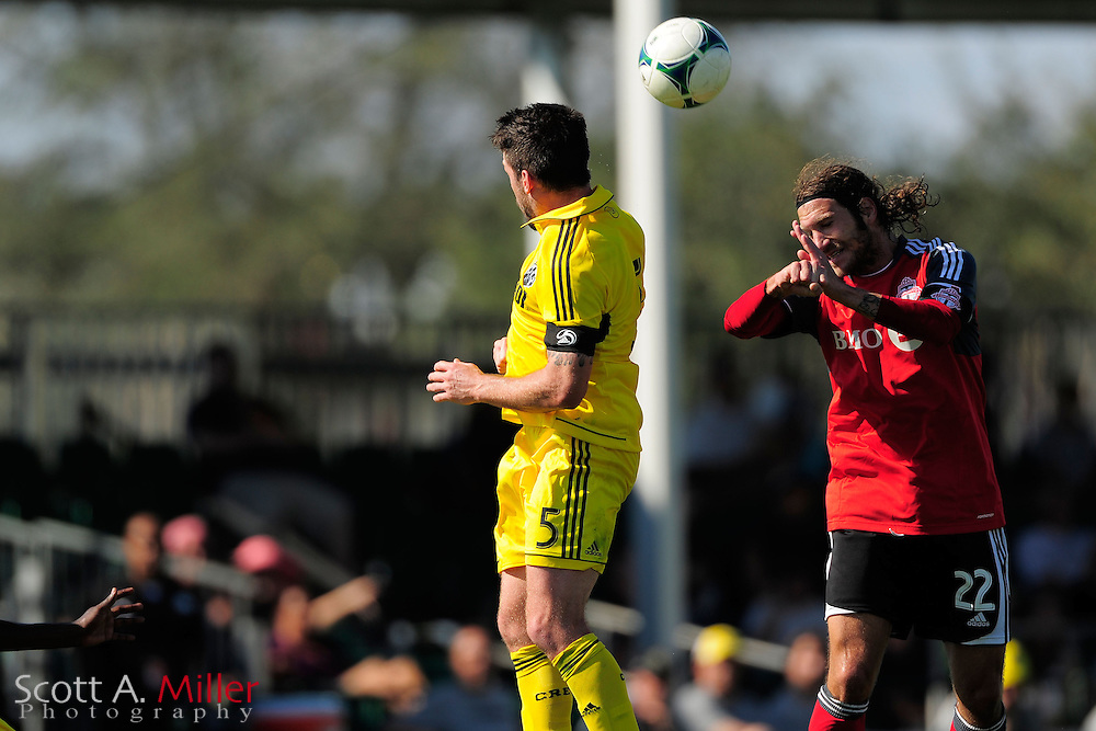Columbus Crew forward Justin Meram (9) and Toronto FC midfielder Torsten Frings (22) go airborne for a ball during the Disney Pro Soccer Classic on Feb 9, 2013  in Lake Beuna Vista, Florida. ..©2013 Scott A. Miller