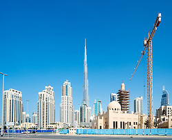 Skyline of Burj Khalifa and apartment towers  at new Business Bay commercial and residential area in Dubai United Arab Emirates