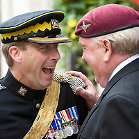 Homecoming March through Perth by the Royal Scots Dragoon Guards and the Militray Brass Band of the Heavy Cavalry to mark Armed Forces Day.......Pictured Lt Col Jonathan Biggart CO Royal Scots Dragoon Guards shares a joke with Parachute Regiment veteran Charlie Lennon from Perth.<br /> Picture by Graeme Hart.<br /> Copyright Perthshire Picture Agency