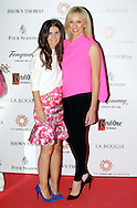 27/9/14***NO REPRO FEE*** Pictured is Ciara Hickey and Caroline Hanratty as Dublin's ladies turn out for a fashionable Cocktail Evening in aid of the Caroline Foundation Pic: Marc O'Sullivan  Friday 26th September: Last night saw a slice of high-end NY style hit Dublin, arriving at The Four Seasons.  Stylish ladies turned out in force to support the event and to mark the start of Breast Cancer Awareness month. The fundraiser, which was a sell-out was the brainchild of Paula McClean a breast cancer survivor and tireless fundraiser. Combining her love of fashion and a good party, the first Cocktail Club Event was born. With a great night of style, fun and raising a lot of money for cancer research, it is no wonder it was a sell- out.  The lucky ladies were treated to a special fashion Show by Brown Thomas who show cased their designers in a salon style. The show featured a selection of key looks mirroring trends from the international runways. The mood for AW14 is easy, elegant, casual and chic. New labels to love include Jenny Packham, Valentino, Osman, Brunello Cucinelli and Moschino. Curated by the affable Michelle Curtain, the clothes were a show-stopper. In keeping with the era of the collection, the evening had a distinctive New York retro theme. Signature 'Original' cocktails from The Four Seasons, featuring Tanqueray London Dry Gin and Ketel-One with the trademark Copper Kettle serve, were the order of the day with eclectic tunes from club DJ Dom to keep the party going. All the lucky ladies went home with a luxury La Bougie Candle. The inaugural Cocktail Club in aid of the Caroline Foundation is the brainchild of Paula McClean a breast cancer survivor and tireless fundraiser. Commenting on the evening, 'Breast Cancer and the Caroline Foundation are very close to my heart and combining this with my love of fashion and a good party, we came up with the first Cocktail Club. We are looking forward to a great night of style, fun and raising a lot of money fo