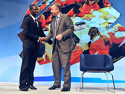 © Licensed to London News Pictures. 04/10/2011. MANCHESTER. UK. Michael Gove MP shakes hands with Quddus Akinwale, a Year 13 Pupil at Burlington Danes Academy, after he addresses the conference. The Conservative Party Conference at Manchester Central today, October 4, 2011. Photo credit:  Stephen Simpson/LNP