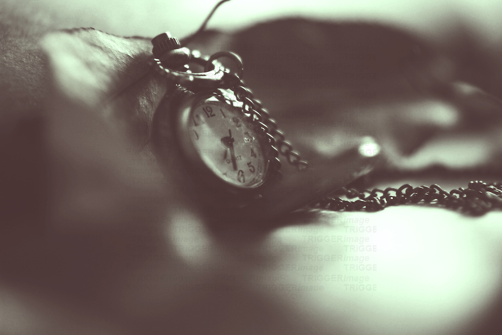 close up of a pocket watch in black and white