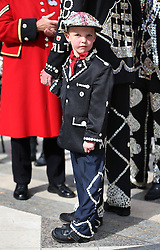 © Licensed to London News Pictures. 27/09/2015. London, UK. The Pearly Prince of Woolwich stands with family members in Guildhall Square for a Harvest Festival celebration. Photo credit: Peter Macdiarmid/LNP