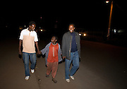 Mkombozi street workers Respick John and Theobald Mariki walking down the street with Jackson, a 10-year-old boy who lives on the streets after being sexually abused. Both perpetrators are now in jail. There are currently 1416 street children in Moshi, and the numbers are increasing. They are deprived of family care and protection, and are often subject to abuse. Mkombozi work with street children in Moshi, providing; shelter, education, counselling and provisions.