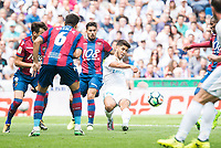 Real Madrid's Marco Asensio and Levante's Tono Garcia and Chema Rodriguez during La Liga match between Real Madrid and Levante UD at Santiago Bernabeu Stadium in Madrid, Spain September 09, 2017. (ALTERPHOTOS/Borja B.Hojas)