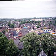 NLD/Huizen/19930929 - Overzicht vanaf de Oude kerk Huizen van de Oude Raadhuisplein en in aanbouw zijnde winkelcentrum