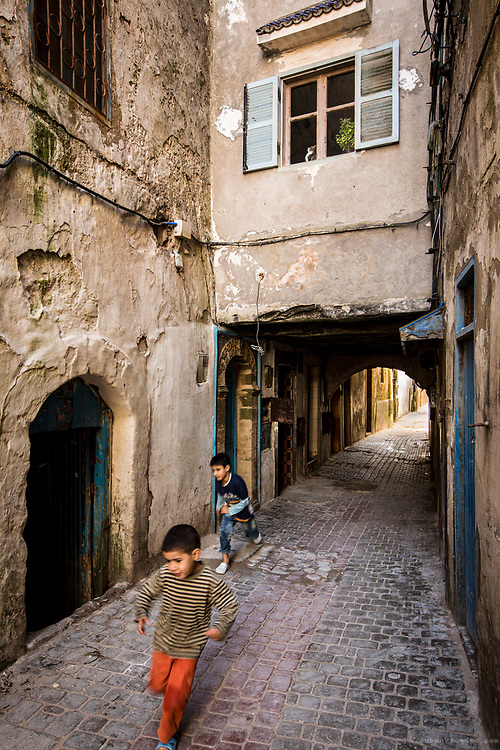 Kids running in Essaouira medina. Morocco