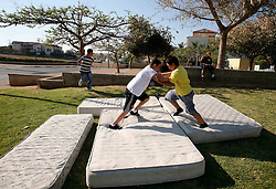 Sderot  - May 2nd ,  2008 - Teenagers use old mattresses  to play fight on in Sderot, Southern Israel, The small town has frequent rocket  attacks from Gaza, May 2nd, 2008. Picture by Andrew Parsons / i-Images
