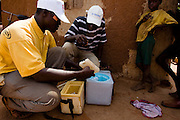 Health workers and volunteers prepare to vaccinate children in the village of Wantugu, northern Ghana, during a national polio immunization exercise on Friday March 27, 2009.