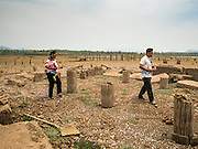 02 APRIL 2016 - NA SAK, LAMPANG, THAILAND:  A Thai family walks into the ruins of the Buddhist temple in Sobjant village. The village of Sobjant in Na Sak district in Lampang province was submerged when the Mae Chang Reservoir was created in the 1980s. The village was relocated to higher ground a few kilometers from its original site. The drought gripping Thailand drained the reservoir and the foundations of the Buddhist temple in the original village became visible early in 2016. Thai families come down to the original village to pray in the ruins of the temple and look at what's left of the village. This is the first time in more than 30 years that this area has not been under two meters of water.     PHOTO BY JACK KURTZ