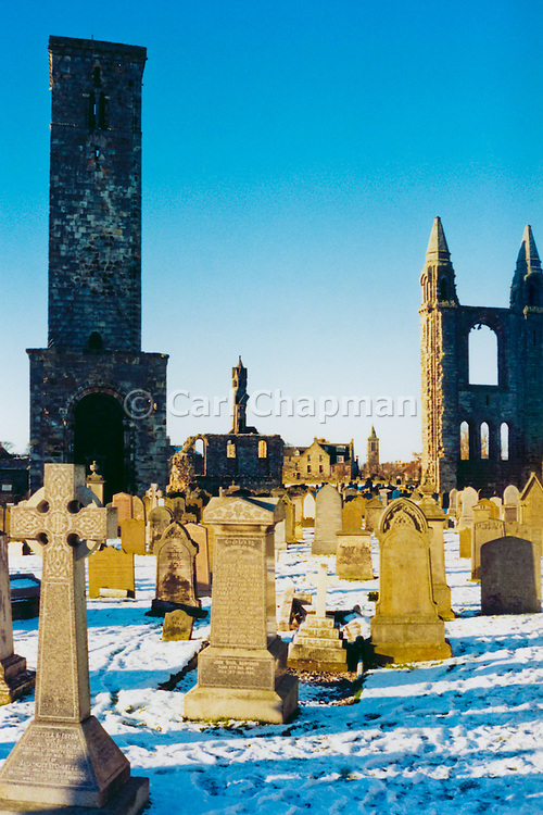 Gravestones in cemetery during snowy winter. St Andrews, Scotland