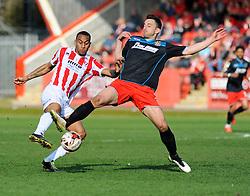 Cheltenham Town's Danny Haynes and Stevenage's Dean Wells battle for the ball. - Photo mandatory by-line: Nizaam Jones - Mobile: 07966 386802 - 06/04/2015 - SPORT - Football - Cheltenham - Whaddon Road - Cheltenham Town v Stevenage - Sky Bet League Two
