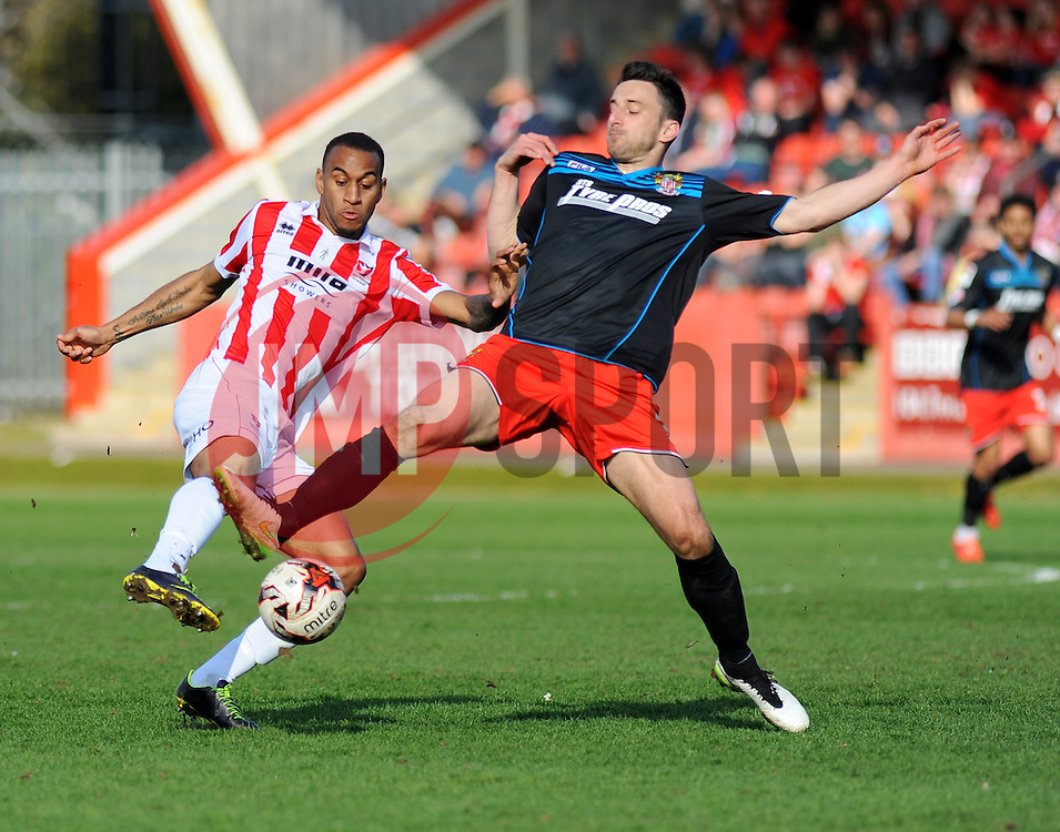 Cheltenham Town's Danny Haynes and Stevenage's Dean Wells battle for the ball. - Photo mandatory by-line: Nizaam Jones - Mobile: 07966 386802 - 06/04/2015 - SPORT - Football - Cheltenham - Whaddon Road - Cheltenham Town v Stevenage - Sky Bet League Two