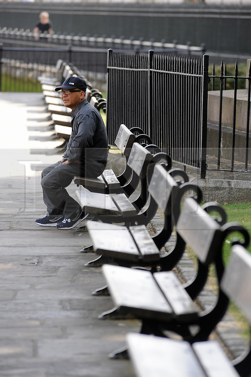 © Licensed to London News Pictures. 18/06/2015<br /> A man sitting near the Royal Naval College,Greenwich.<br /> Greenwich Sunny weather in South East London,UK.<br /> Early morning sunny weather in Greenwich Village and Greenwich Park today (18,06,2015)<br /> (Byline:Grant Falvey/LNP)