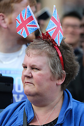 © Licensed to London News Pictures. 28/09/2016. Leeds, UK.  A woman wearing union jacks on her head during the Olympic and Paralympic parade in Leeds. Yorkshire's Olympic and Paralympic stars receive a heroes' welcome during an open top bus parade in Leeds, West Yorkshire.  Photo credit : Ian Hinchliffe/LNP