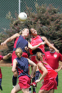 29 July 2006: Abby Wambach (left) and Natasha Kai (right) knock heads while battling for a ball in training. The United States Women's National Team trained at SAS Soccer Park in Cary, North Carolina, in preparation for an International Friendly match against Canada to be played on Sunday, July 30.
