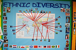 Map on school wall showing global ethnic diversities,