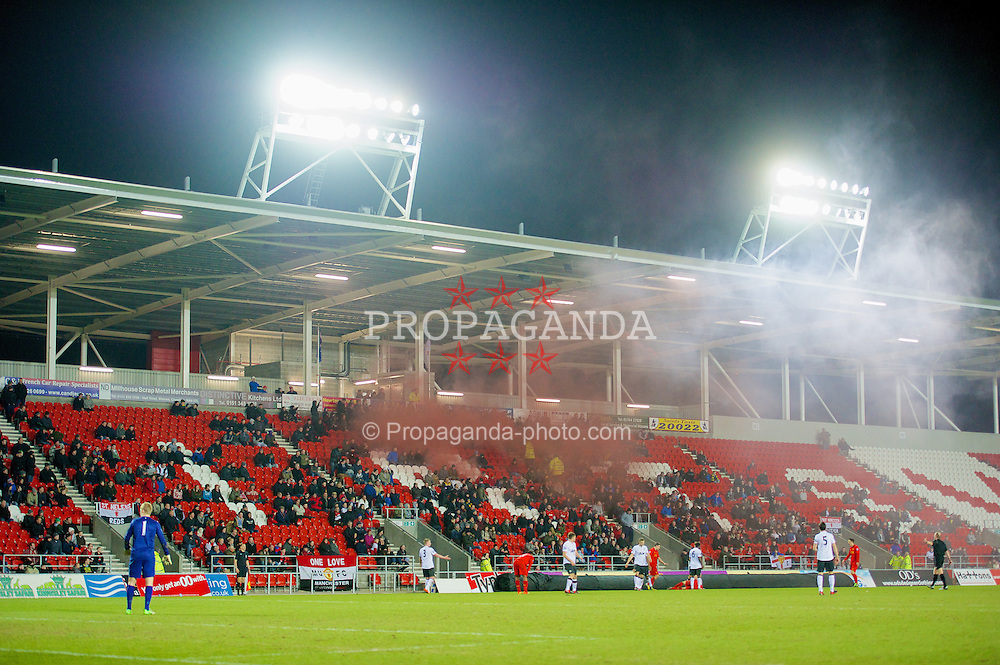 ST HELENS, ENGLAND - Monday, February 25, 2013: Manchester United supporters set off two smoke bombs during the Premier League Academy match against Liverpool at Langtree Park. (Pic by David Rawcliffe/Propaganda)