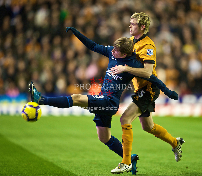 WOLVERHAMPTON, ENGLAND - Saturday, November 7, 2009: Arsenal's Andrei Arshavin and Wolverhampton Wanderers' Richard Stearman during the Premiership match at Molineux. (Photo by David Rawcliffe/Propaganda)