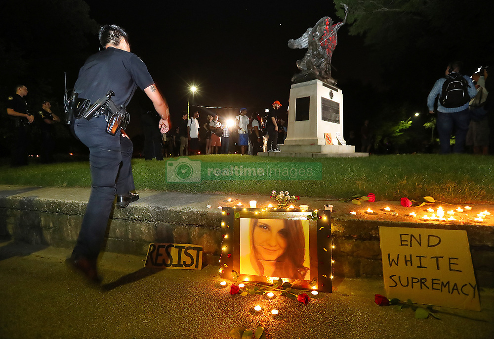 Atlanta Police move into Piedmont Park to prevent protesters during a anti white nationalism memorial and march in response to violence in Virginia from toppling a Confederate monument with a chain after they spray painted it on Sunday, Aug. 13, 2017, in Atlanta. The peace monument at the 14th Street entrance depicts a angel of peace stilling the hand of a Confederate soldier about to fire his rifle. Photo by Curtis Compton/Atlanta Journal-Constitution/TNS/ABACAPRESS.COM