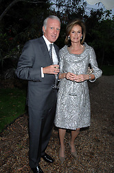 JOHAN BECK and MRS BEAU MATHIEU at the annual Cartier Chelsea Flower Show dinner held at the Chelsea Physic Garden on 21st May 2007.<br />