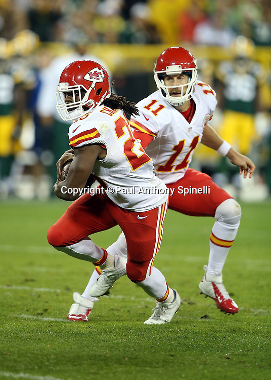 Kansas City Chiefs running back Jamaal Charles (25) takes a second quarter handoff from Kansas City Chiefs quarterback Alex Smith (11) on a 9 yard run for a second quarter touchdown that cuts the Green Bay Packers lead to 17-7 during the 2015 NFL week 3 regular season football game against the Green Bay Packers on Monday, Sept. 28, 2015 in Green Bay, Wis. The Packers won the game 38-28. (©Paul Anthony Spinelli)