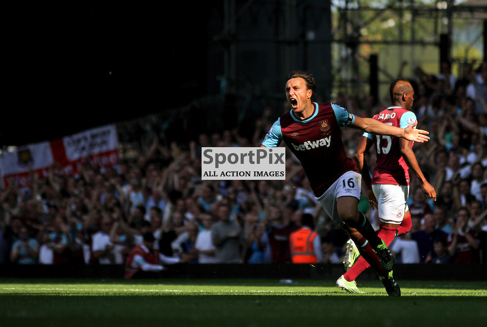 Mark Noble celebrates through a break of light During West Ham United vs Bournemouth FC on Saturday the 22nd August 2015